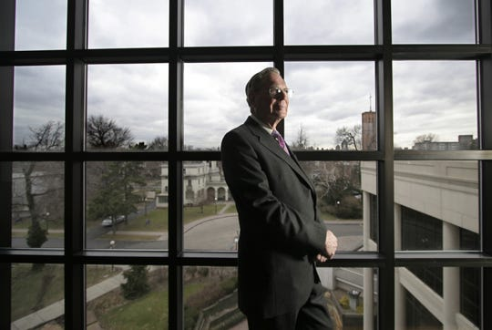 John Riedman, in 2006, posed in the new Riedman Gallery on the third floor of the Rochester Museum and Science Center. Riedman donated one million dollars to fund the addition.