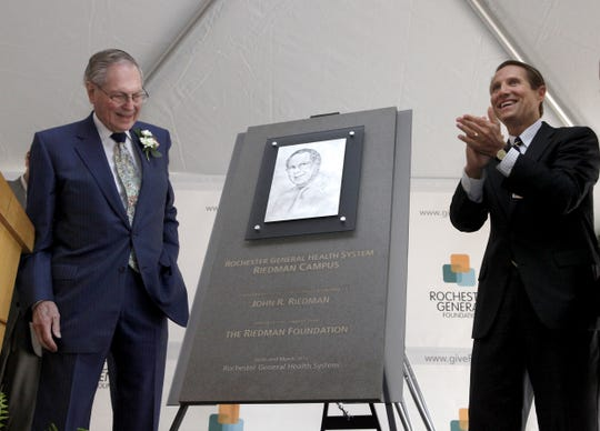 Mark Clement, right, then president of the Rochester General Health System, presented a plaque to John Riedman during the dedication of the the Riedman Campus. Riedman donated $2.5 million for the new facilities in Irondequoit.