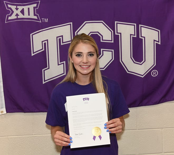 Sonora High School senior Lane Cahill shows her agreement with Texas Christian University to continue her pole vaulting career next season. Cahill committed to TCU at a ceremony Friday, May 17, 2019, at Sonora High School.