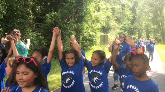 Second graders from Kiptopeke Elementary School hiked part of the Southern Tip Bike and Hike Trail near Capeville, Va., on Friday to attend a dedication ceremony for the trail.