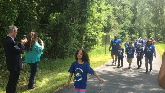 Second graders from Kiptopeke Elementary School hiked part of the Southern Tip Bike and Hike Trail near Capeville, Virginia on Friday, May 17, 2019 to attend a dedication ceremony for the trail.