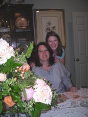 Tracy Prestwood and daughter, 2019 Demoiselle Deb Sarah Grace Prestwood, at the Calendar Luncheon. Centerpiece flowers by Kyle Loyd.