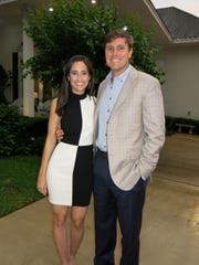 Caroline Hagan and Travis Scott arrive for the Russell-Casten engagement announcement party.