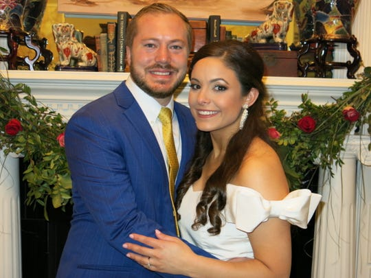 Bradley Curtis Russell and fiancee Elizabeth Marie Casten at their engagement announcement party for 200.