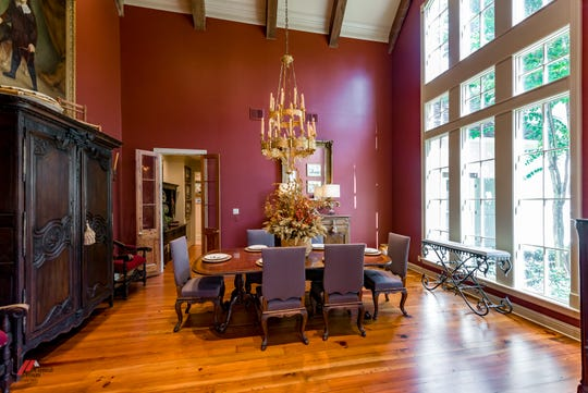 The formal dining room with a soaring ceiling sets the stage for a fancy dinner.