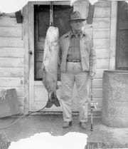 Roy Groves with a 55-pound catfish caught in 1949. For nearly 70 years it stood as South Dakota's record channel catfish until it was voided on May 20, 2019. South Dakota Game, Fish and Parks determined the fish was a blue catfish.
