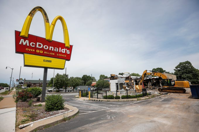 Crews work to demolish the McDonald's at 501 W. Sunshine Street on Monday, May 20, 2019.