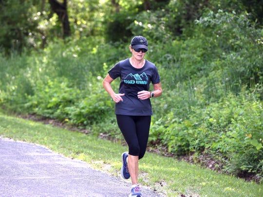 Ultrarunner Sandy Powell runs along Old Greenville Road on Friday, May 10.