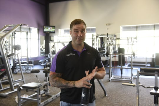 John Schultz, owner of Anytime Fitness in Sauk Rapids, explains the personal training model used at the gym Monday, May 20. Schultz and his wife will open another Anytime Fitness in Sartell this summer.