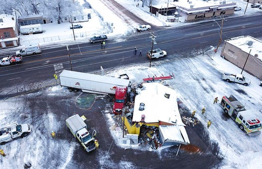 FILE - This Jan. 16, 2019 photo taken by a Utah Highway Patrol drone shows a big rig that has crashed into a resaturant in Wellington, Utah. In Utah, drones are hovering near avalanches to measure roaring snow. In North Carolina, they're combing the skies for the nests of endangered birds. In Kansas, meanwhile, they could soon be identifying sick cows through heat signatures. A survey released Monday, May 20, 2019 shows transportation agencies are using drones in nearly every U.S. state. (Utah Highway Patrol via AP, File)