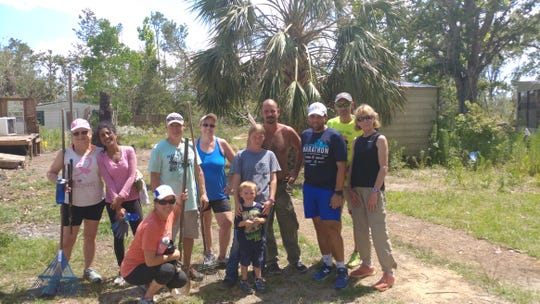 A Crew from Saturday's Catfish Crawl 5K in Blountstown teamed up to help clear up yard debris for a veteran.
