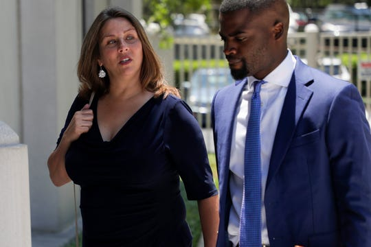 Former Downtown Improvement Authority Executive Director Paige Carter-Smith walks into the U.S. District Courthouse with her attorneys for her rearraignment on public corruption charges Monday, May 20, 2019.