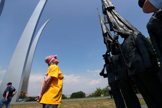 Gail Davies, 75, a Vietnam War veteran who served in the Air Force, looks up at the Honor Guard statues at the Air Force Memorial Saturday, May 18, 2019. Davies was the only female veteran to attend Honor Flight Tallahassee.
