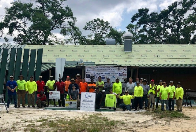 Capital City  Roofing members helped reroof Wallwood Boy Scouts reservation.