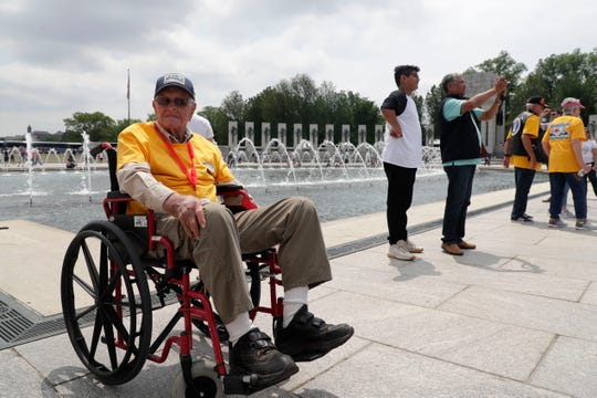 Vernon Guthrie, 99, a World War II veteran who served in the Army, sits at the World War II Memorial and pays his respects to his fellow soldiers Saturday, May 18, 2019. Guthrie was the oldest and one of five World War II veterans from the Tallahassee area to attend the trip to the Washington, D.C.