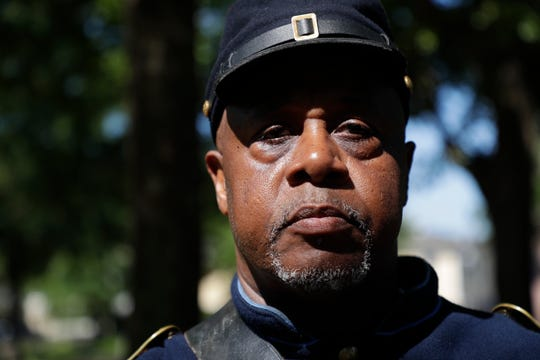 Sgt. Major Jarvis Rosier poses in his uniform as a member of the 2nd Infantry Regiment United States Colored Troops, a group that he started in Tallahassee, after the group gave a 21 gun salute and played taps during a commemorative grave decorating ceremony in honor of Emancipation Day at Old City Cemetery Monday, May 20, 2019.