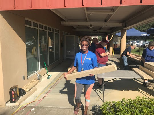 Volunteers build beds to be delivered in Blountstown and Marianna.