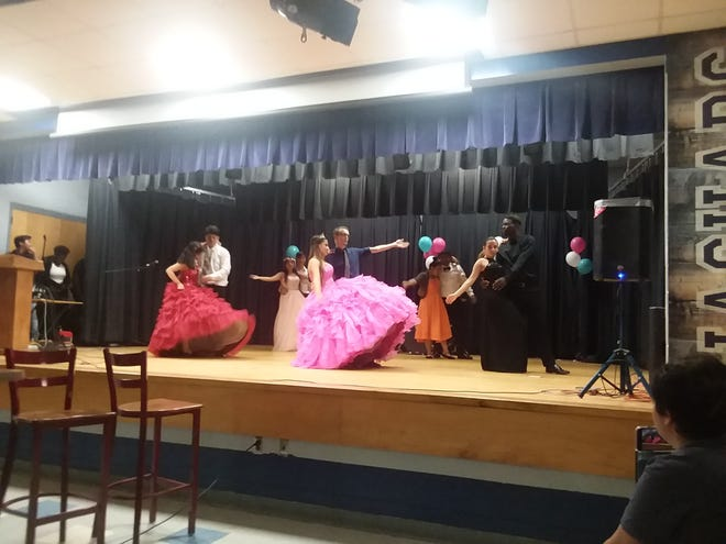 Gadsden High students participate in the Quinceañera. From left to right, Natalia Menjivar and Carlos Barrios, Christopher Rodier and Jennifer Arroyo, Maybelline Somoza and Jacob Nealy.