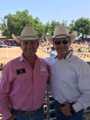 Rodeo announcer Chad Nicholson and Tulare County Mike Boudreaux pose for a photo at the annual Woodlake Lions Rodeo.