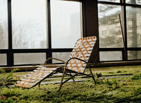 "A lounge chair beside the indoor pool at Grossinger's Catskill Resort and Hotel in Liberty, New York, as captured by Marisa Scheinfeld in her 2016 book, ""The Borscht Belt: Revisiting the Remains of America's Jewish Vacationland."""