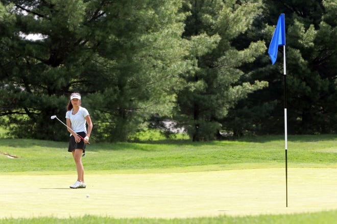 Kaitlyn Lee of Scarsdale follows her putt on the 8th hole during round 1 of the Section 1 girls golf tournament May 20, 2019 at Centennial Golf Club in Carmel.
