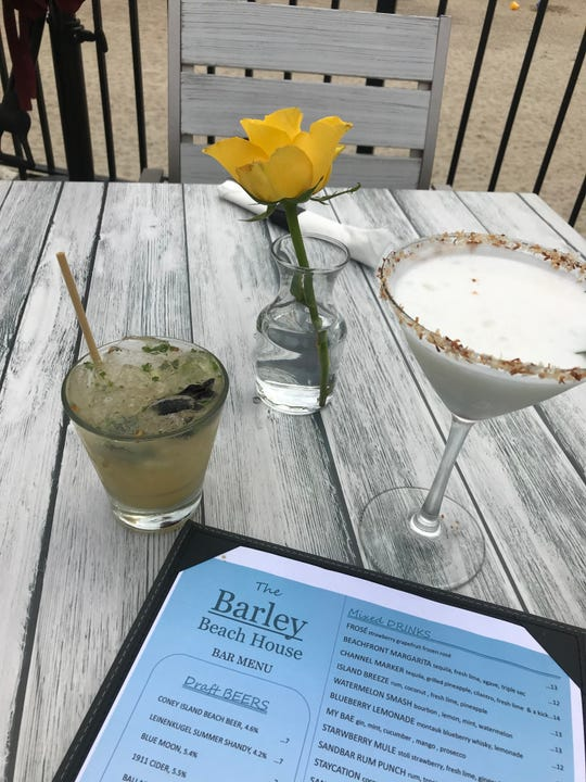 Cocktails with a water view: the the Channel Marker (tequila, grilled pineapple cilantro, fresh lime and a little kick), left, and the Island Breeze (rum, coconut, fresh lime and pineapple) at The Barley Beach House in Rye.