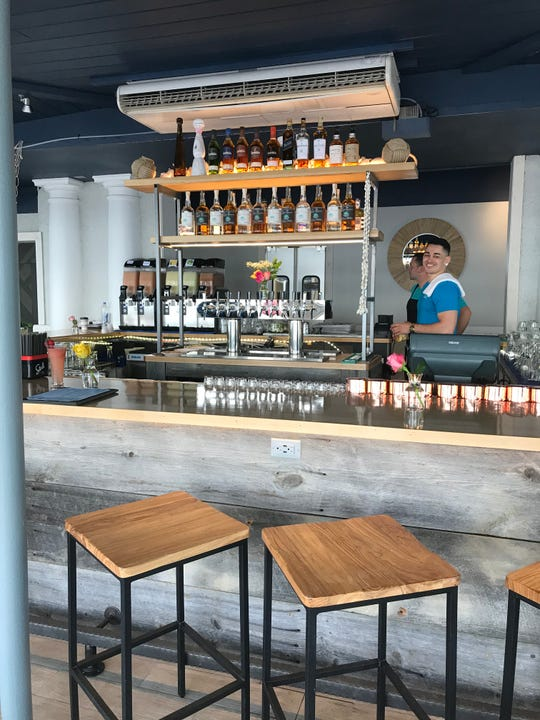 Bartender Lou DeAza at the new bar at The Barley Beach House in Rye.