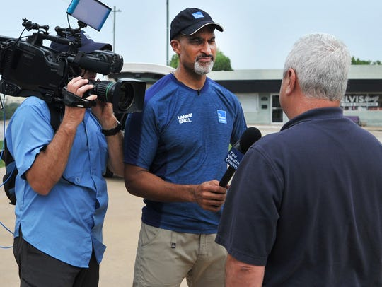 Weather Channel meteorologist, Paul Goodloe interviews Wichita County emergency coordinator, Lee Bourgoin during the channel's weather coverage of North Texas Monday afternoon.