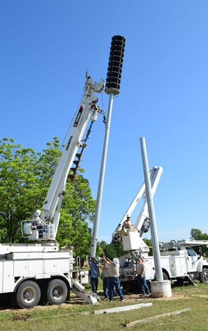 Bowie, Texas, electric crews began placing warning sirens on the utility poles that had already been placed on the concrete base. These poles are big, towering some 60 feet high, which is 15 feet higher than the average utility pole.