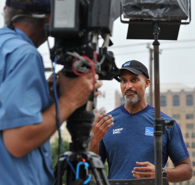 Weather Channel meteorologist Paul Goodloe talks to his television viewers about how to stay weather informed with cellphone technology during the channel's severe weather broadcast from downtown Wichita Falls Monday afternoon.