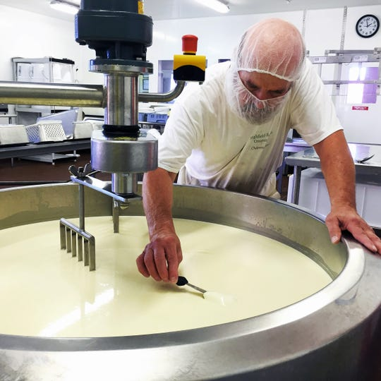 Terry Woods checks a batch of cheese at Highfield Farm Creamery in Walworth.