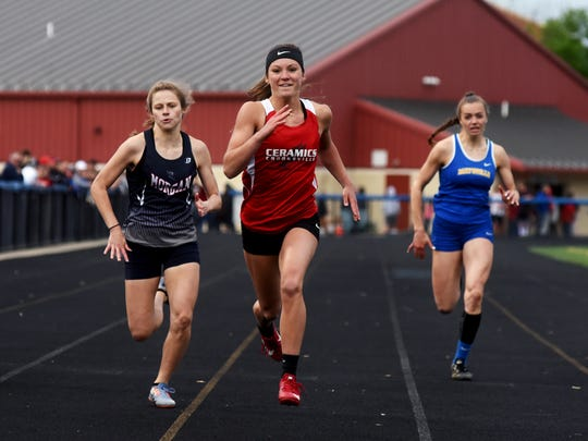 Crooksville's Greta Barker, middle, sprints to a win in the 200 during the Muskingum Valley League Track and Field Meet at Maysville. Barker has led the Ceramics' resurgence in track this season.