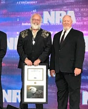 Don Pagath (left) received his Southern Ohio volunteer of the year award during last month's National NRA convention in Indianapolis. Eastern Region Director Bryan Hoover (right) presented the award.