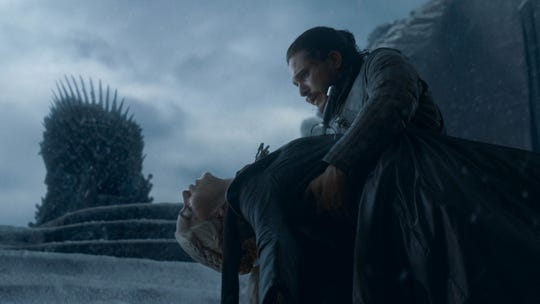 Jon Snow (Kit Harington), right, holds Daenreys Targaryen (Emilia Clarke) after he stabbed her.