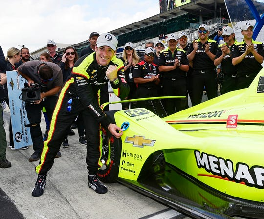 Simon Pagenaud celebrates after winning the pole for the 103rd Indianapolis 500.
