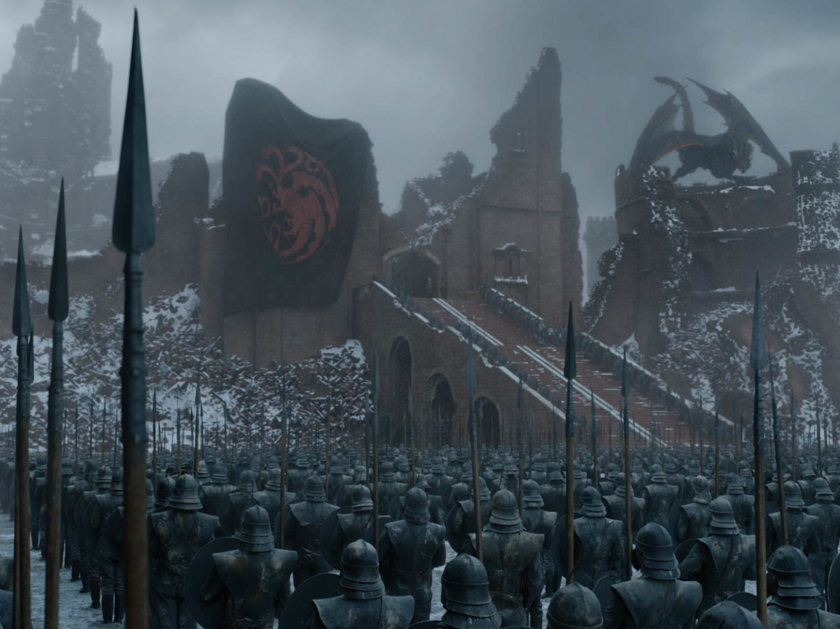 The Targaryen sigil hangs over the ruins of King's Landing after Dany's dragon siege.