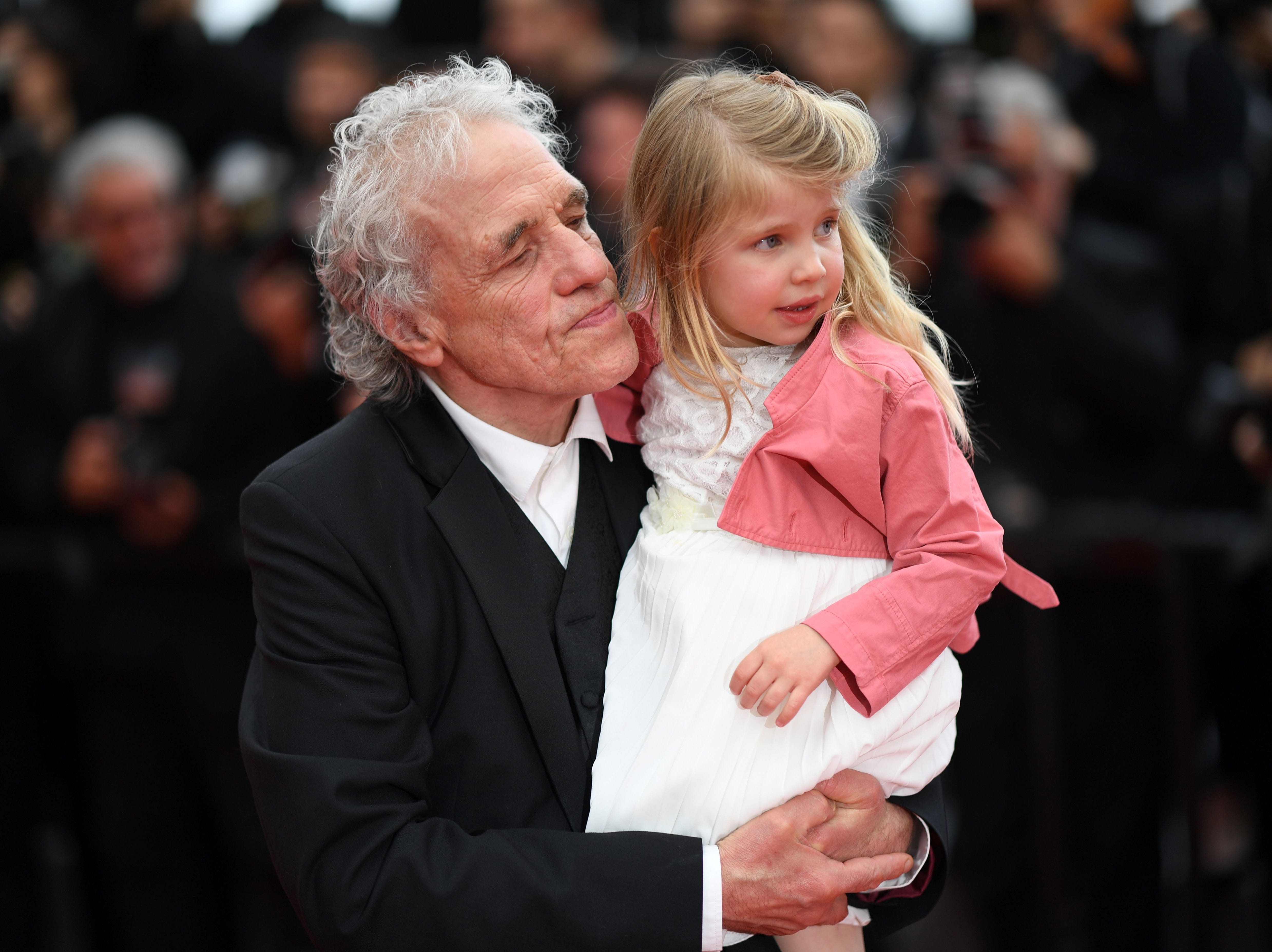 """Director Abel Ferrara arrives with his daughter Anna Ferrara for the screening of film """"Tommaso"""" at the 72nd edition of the Cannes Film Festival in Cannes, France."""