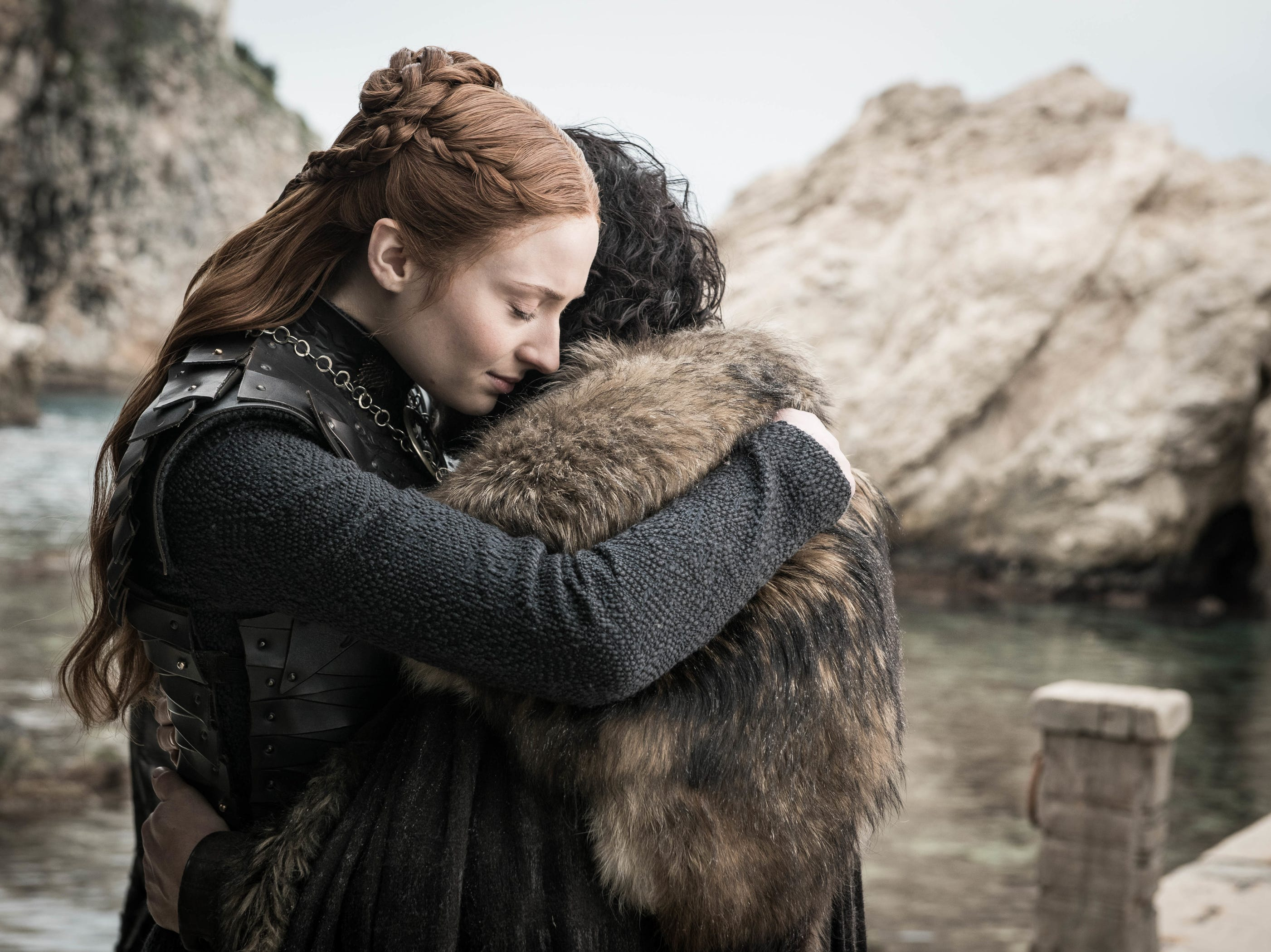 Sansa Stark (Sophie Turner), left, and Jon Snow (Kit Harington) hug before going their separate ways.