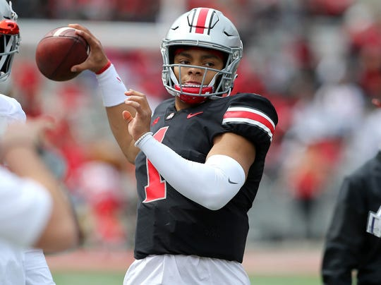 Ohio State quarterback Justin Fields throws on the sideline during the team's spring game in April