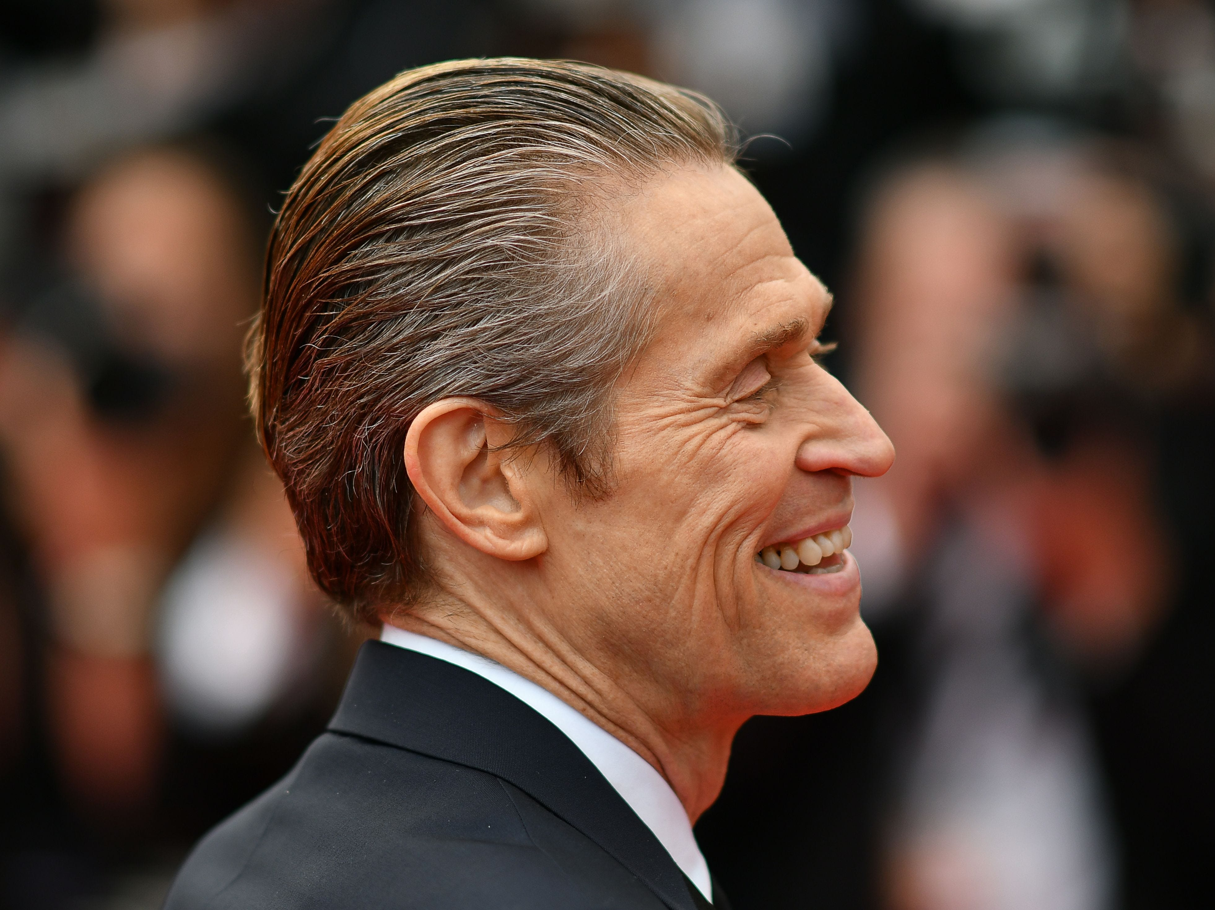 """Willem Dafoe arrives for the screening of film """"Tommaso"""" at the 72nd edition of the Cannes Film Festival in Cannes, France."""