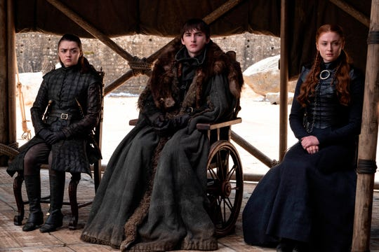 "This image released by HBO shows from left to right Maisie Williams, Isaac Hempstead Wright and Sophie Turner in a scene from the final episode of ""Game of Thrones,"" that aired Sunday, May 19, 2019."