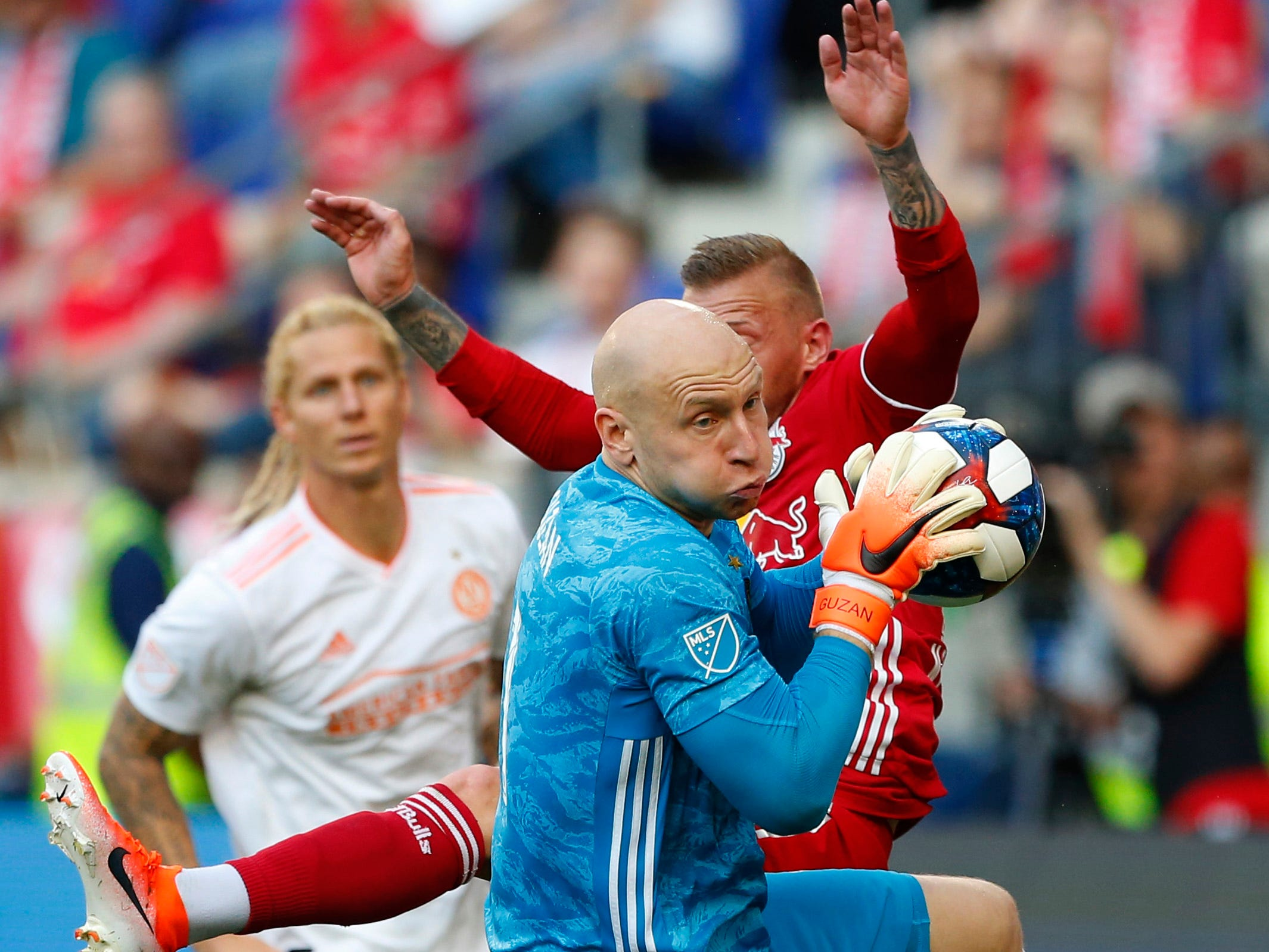 May 19:  Atlanta United FC goalkeeper Brad Guzan makes a save against New York Red Bulls midfielder Daniel Royer during the second half at Red Bull Arena. The New York Red Bulls won the game, 1-0.
