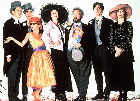 "The cast of ""Four Weddings and a Funeral"" (from left): James Fleet, John Hannah, Charlotte Coleman, Andie MacDowell, Simon Callow, Hugh Grant and Kristin Scott Thomas."