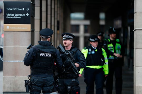 British police secure the area near the Houses of Parliament in London on March 23, 2017, after a terrorist attack.