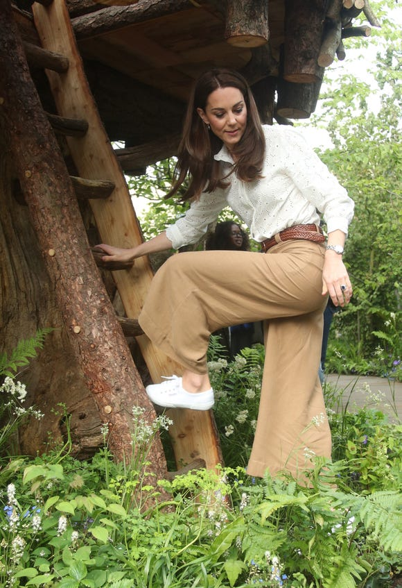 Kate climbs her garden's treehouse.