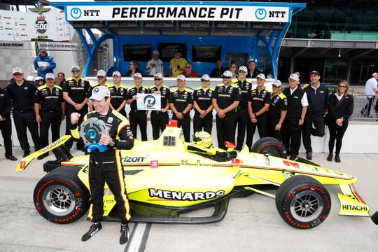 Simon Pagenaud, front, poses with his Team Penske owner and crew after winning the pole for the 103rd Indianapolis 500.