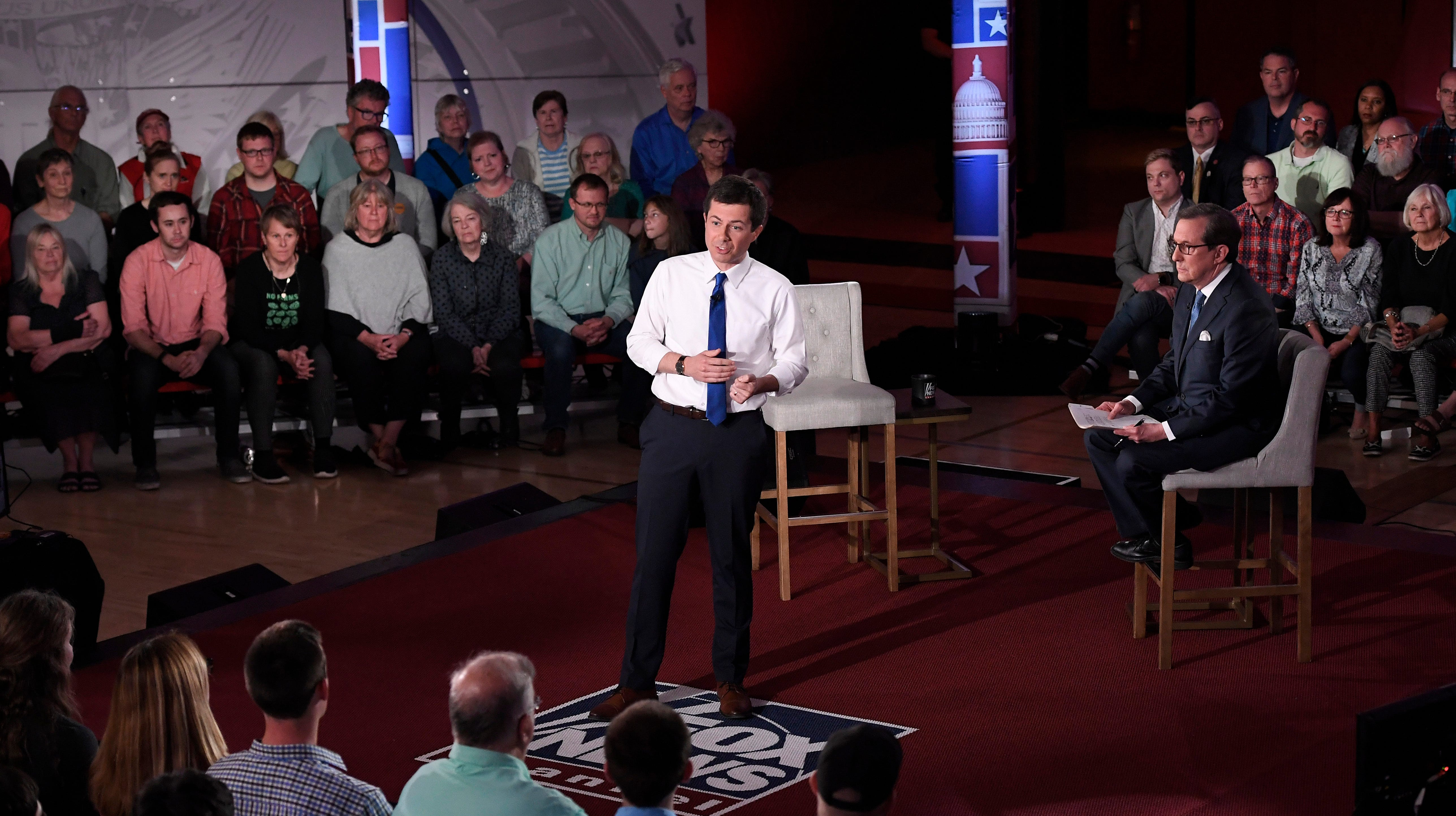Democratic presidential candidate South Bend, Ind., Mayor Pete Buttigieg, center, answers a question during a FOX News Channel Town Hall moderated by Chris Wallace, center right, Sunday, May 19, 2019, in Claremont, N.H.