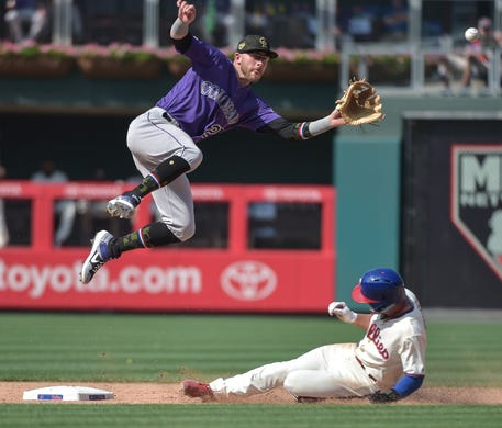 961f55b27 May 19  The Philadelphia Phillies  Scott Kingery steals second as Colorado  Rockies shortstop Trevor