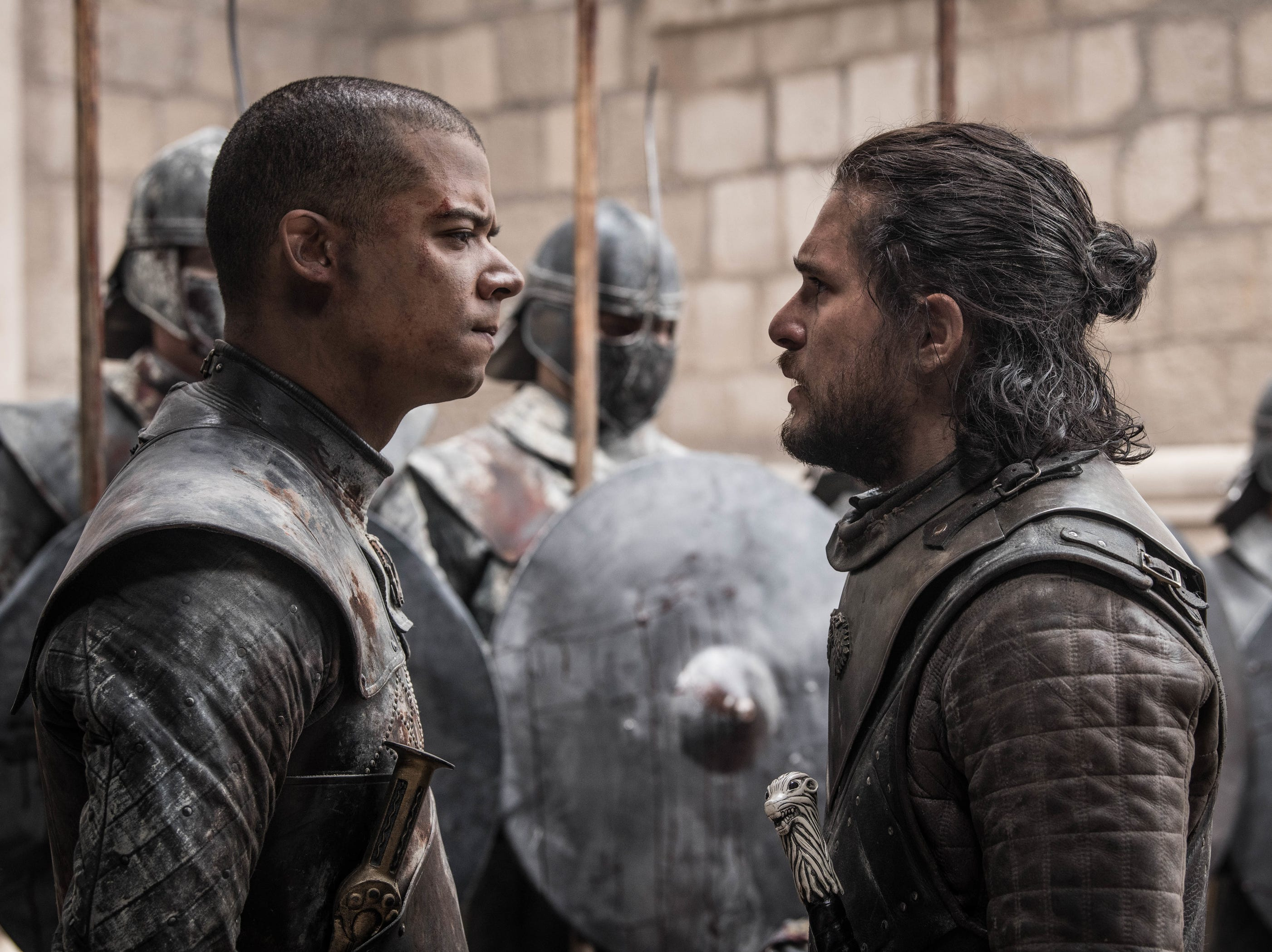 Grey Worm (Jacob Anderson, left) and Jon Snow (Kit Harington) disagree on what to do with Cersei Lannister's defeated soldiers.