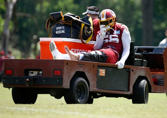 Reuben Foster rides a cart off the field after suffering an injury during a practice Monday.